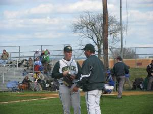 Coach sharing pitching tips with his starter