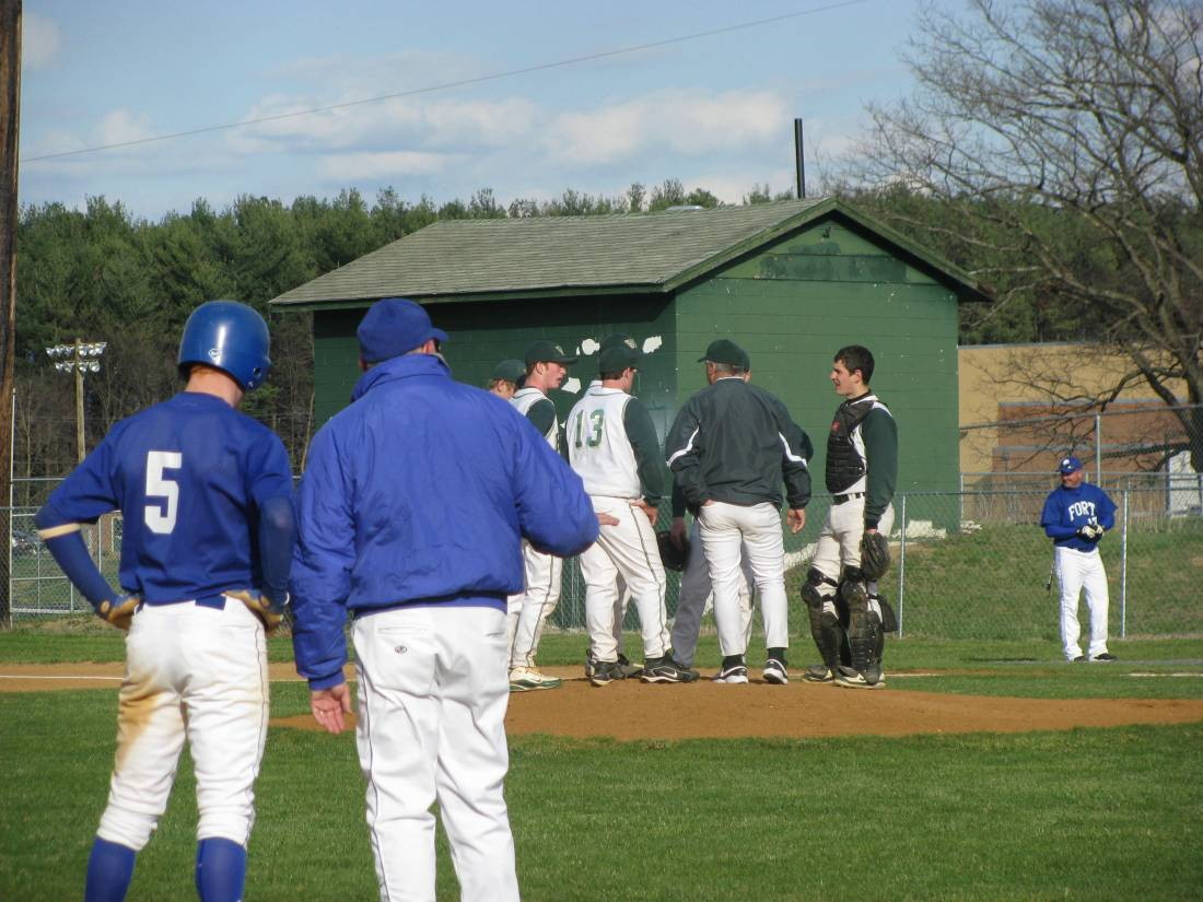 Green meeting on the mound, blue on the base paths