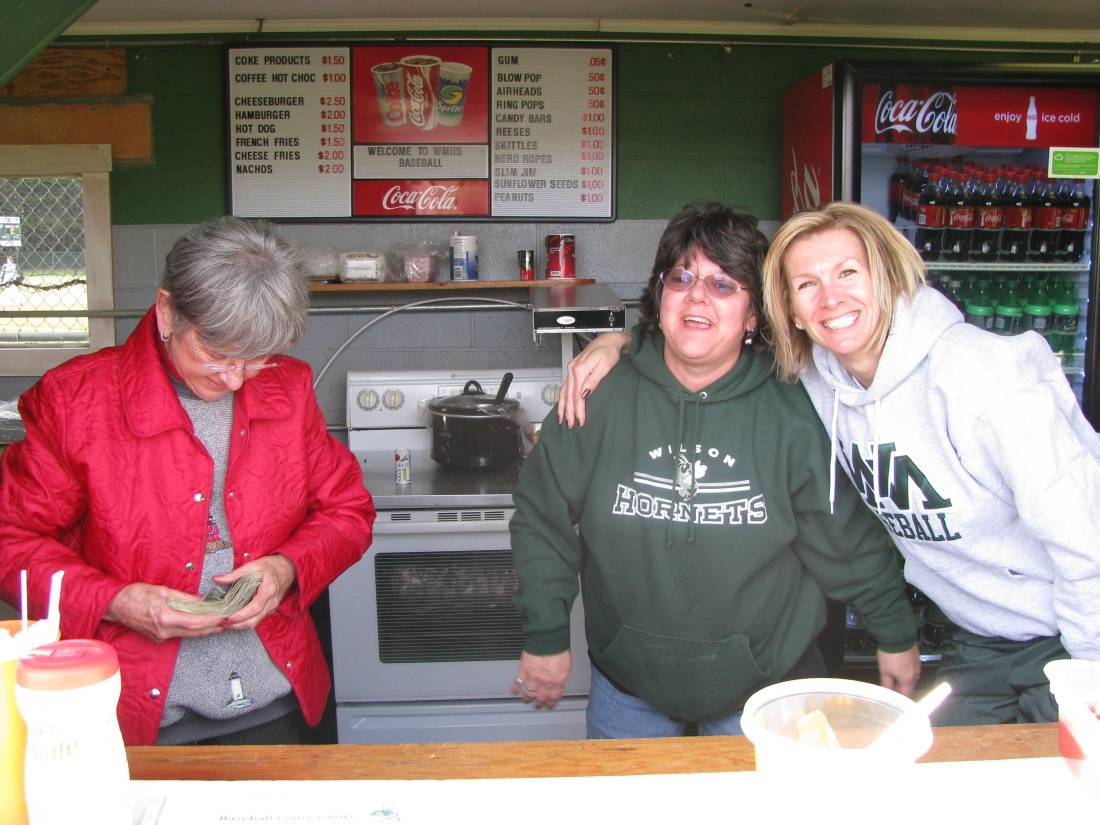 Smiling faces working the concession stand.