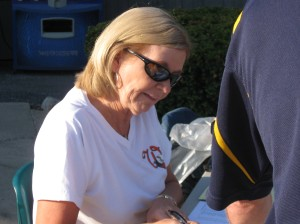 Mrs. R checking in the 92 golfers.