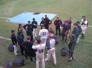 Ness holding team meeting after DH. The teams will play 2 more starting at Noon on Saturday.