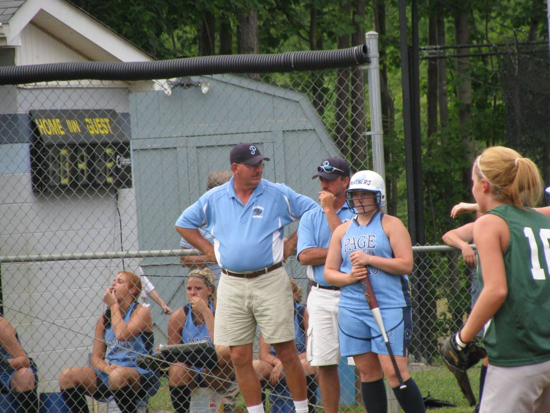 Coach Knight giving on of his Lady Panthers last minute advice.