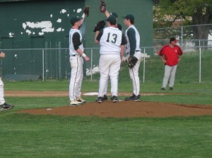 Final meeting on the mound before 1ST pitch