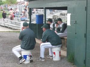 Coach Mac & Coach Cullen sitting and coaching.