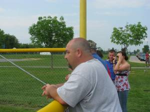 Coach Yew in the park to support his wife & her Falcons.