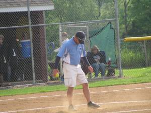 Coach Ralph getting the mound ready in between innings.